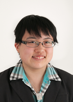 Headshot of young east asian person in business dress.