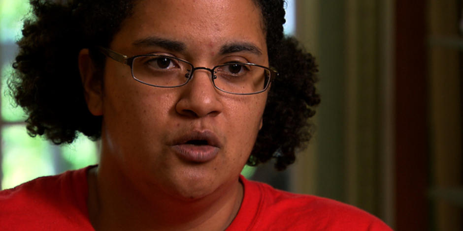 Biracial black woman, Jennifer Msumba, speaking in interview with CBS.
